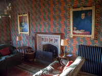 The Grange, Ramsgate: sitting-room so-called, with fireplace desiigned by Augustus Pugin and copies of portraits of Pugin and his third wife, Jane