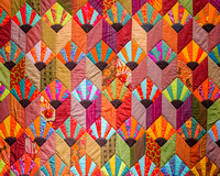 Tumbling Fans Quilt, 2010 by Kaffe Fassett, in his 2014 exhbition at Claverton Manor, Bath