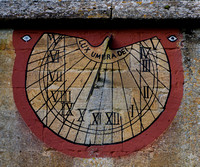 """Light is the shadow of God."" - 18th Century sundial upon St Andrew's Church, Naunton, Gloucestershire"