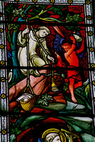 St Benedict's window - Benedict's friend Romanus lowering food to the cave where Benedict lived, while the devil prepares to throw a stone at the warning bell