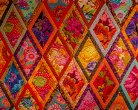 Bordered Diamonds Quilt by Kaffe Fassett, in his 2014 exhbition at Claverton Manor, Bath