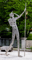 Large modern pilgrim sculpture, by the bridge across the Scherzach river, Weingarten