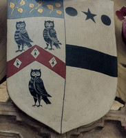 Pershore Abbey: shield of the Haselwood family - Argent a cheveron gules between three owls sable with three lozenges ermine on the cheveron and a chief azure with three hazel branches or therein
